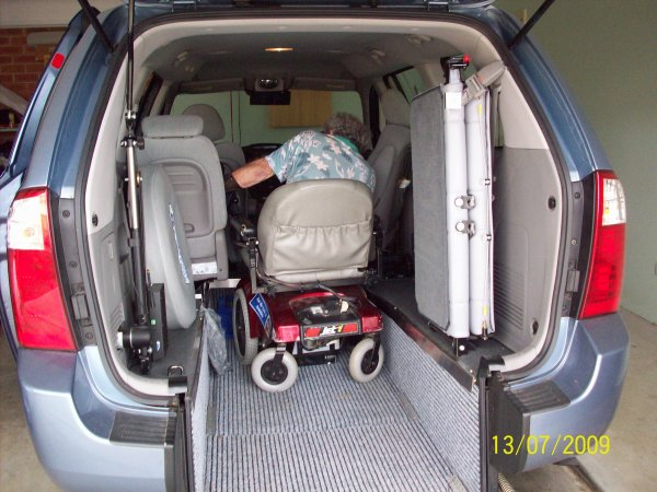 Freedom Motors Australia | Customer Testimonials - Wheelchair Accessible Vehicle Conversions - ../../dc/testimonials/Locking_Chair_into_Floor_Fitting.jpg