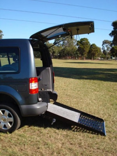 VW Caddy Range wheelchair vehicle - Rear access & wheelchair ramp side view close up