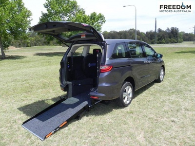 Honda Odyssey wheelchair vehicle - Rear angle view with wheelchair ramp down