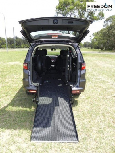 Honda Odyssey wheelchair vehicle - Rear view with wheelchair ramp down