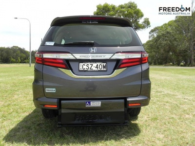 Honda Odyssey wheelchair vehicle - Rear view with wheelchair ramp up and tail gate closed