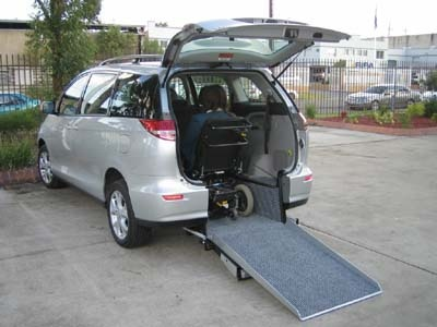 Toyota Tarago wheelchair vehicle - Rear open view with wheelchair in place