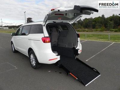 Kia Carnival YP wheelchair vehicle - Rea angle view with ramp down